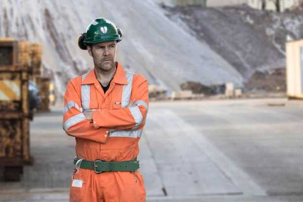 Rhod Gilbert in overalls and hard hat