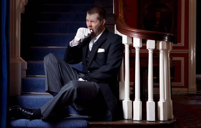 Rhod as Butler, sat on stairs