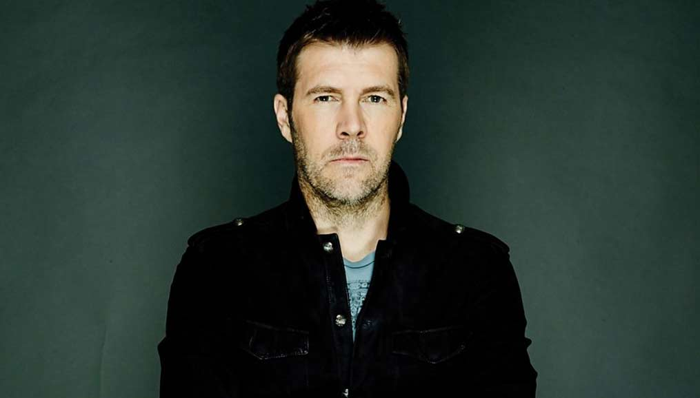 Rhod Gilbert on dark green background